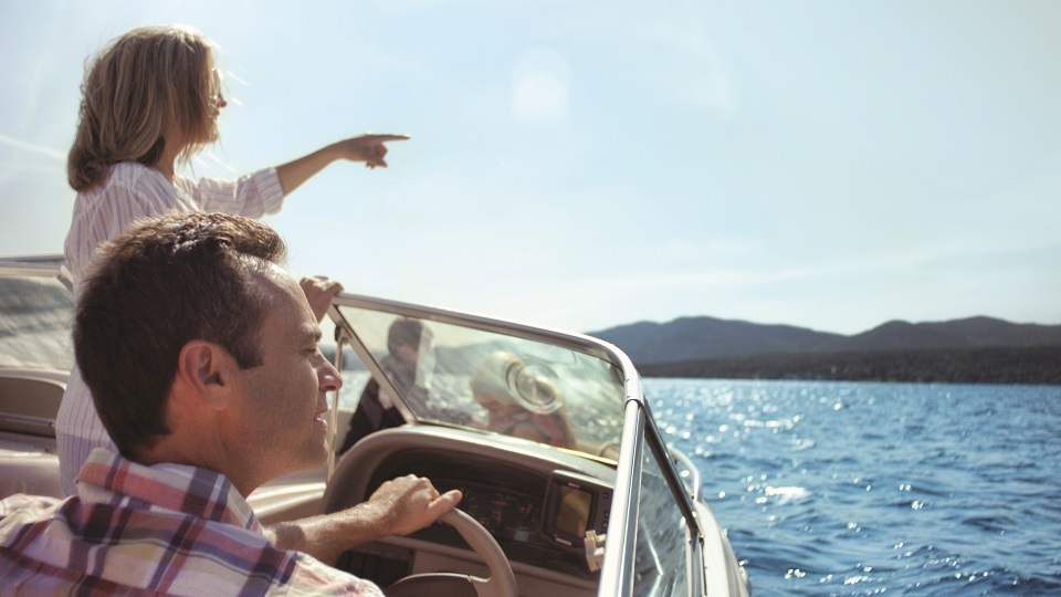 Couple on a motor boat on Lake George