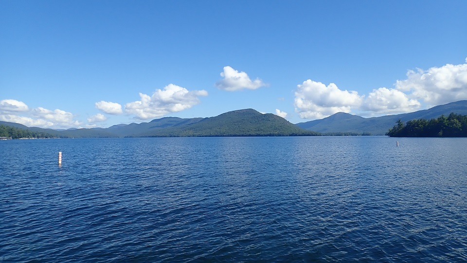 View of the Adirondack Mountains from a boat on Lake George