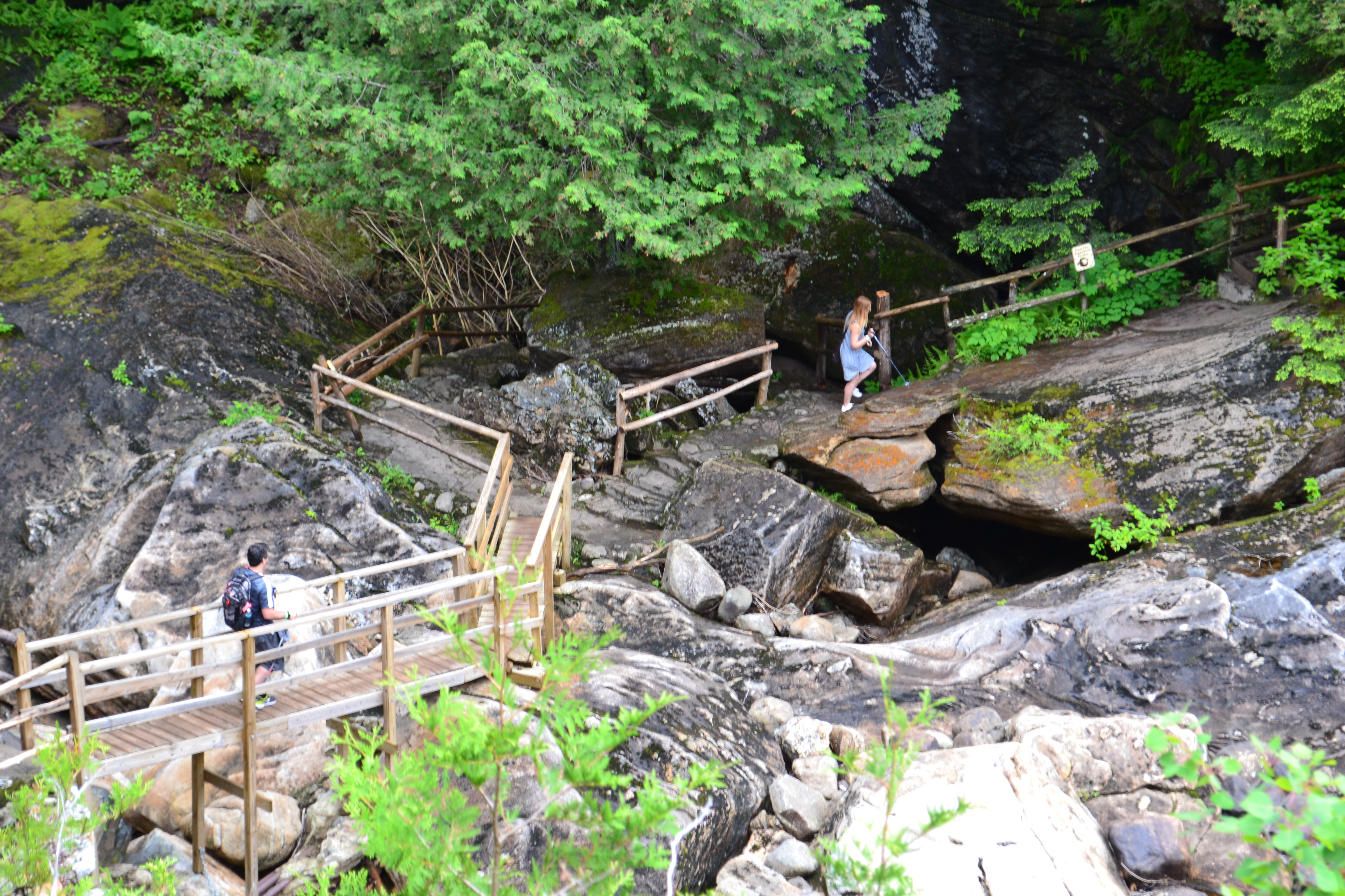 People Hiking at Natural Stone Bridge & Caves