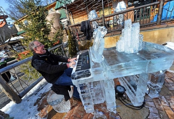 Funky Ice Fest at Adirondack pub and brewery man playing an ice piano
