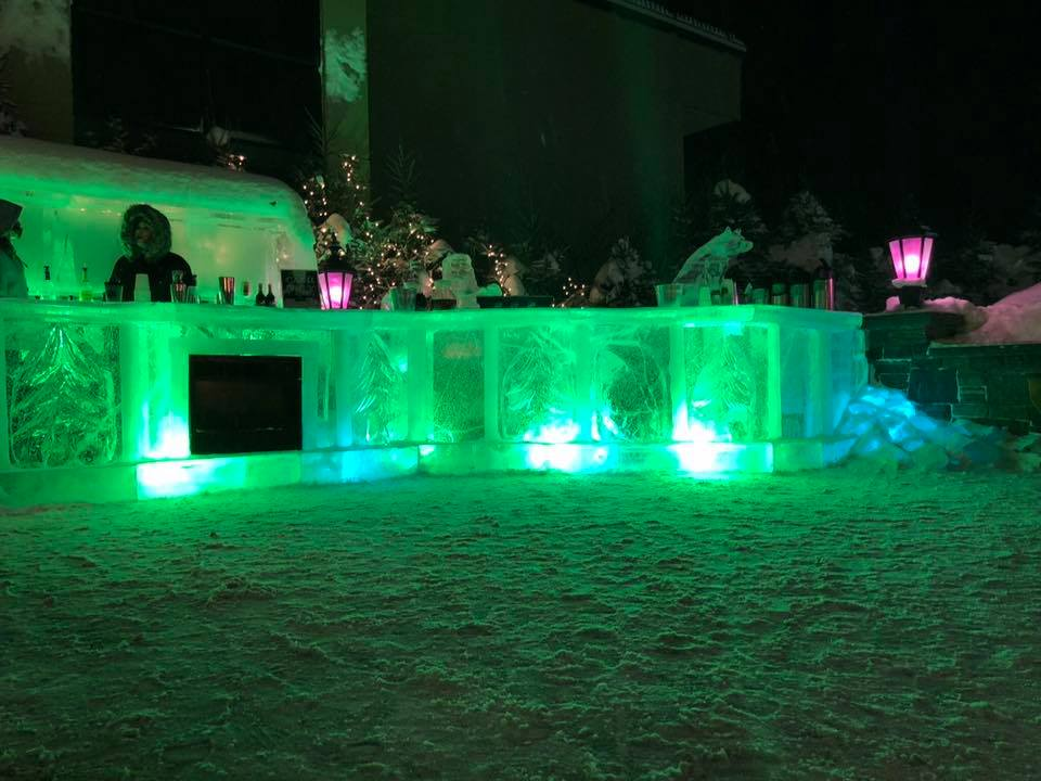 Forest Ice Bar lit with green lights at the Holiday Inn Resort
