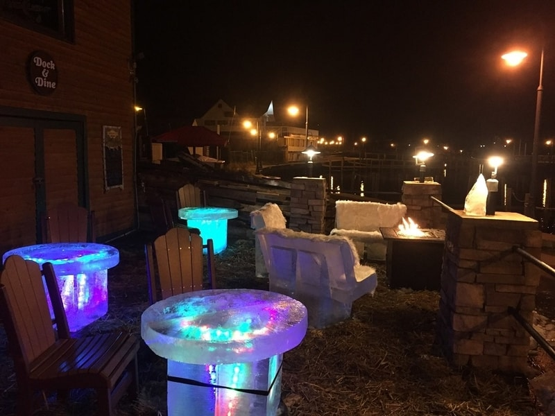 King Neptune's Ice Lounge with ice chairs and ice tables with colorful lights