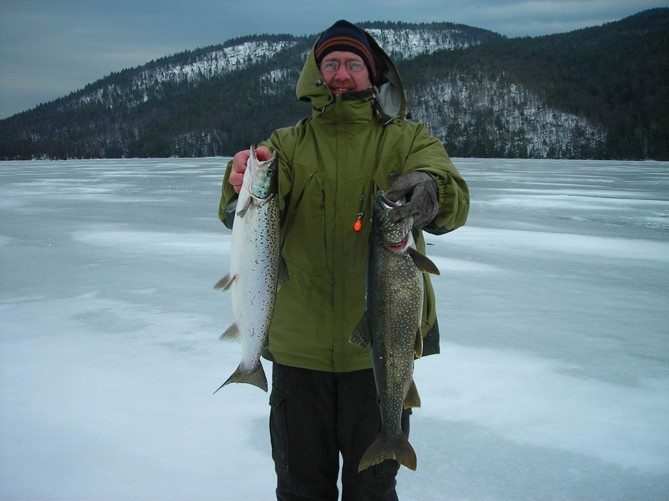 Mike Miller on Lake George with a rainbow and lake trout