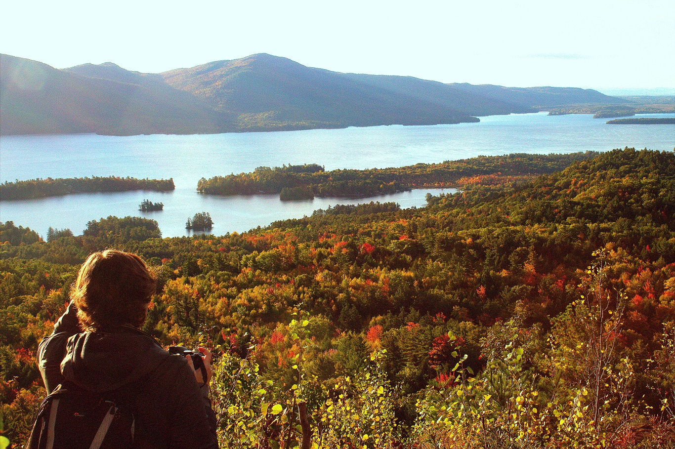 The Pinnacle summit overlooking fall foliage and Lake George